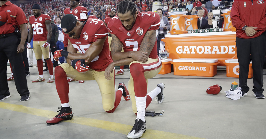 Kaepernick and 49ers safety Eric Reed kneel for the national anthem during their 28-0 win against the LA Rams.