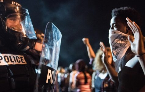 Police officers face off with protesters on the I-85 (Interstate 85) during protests in the early hours of September 21, 2016 in Charlotte, North Carolina.