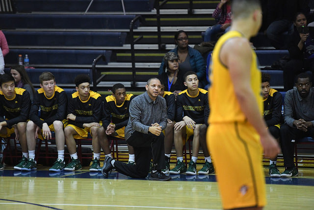 Coach Bentley yells instructions at his players on the court