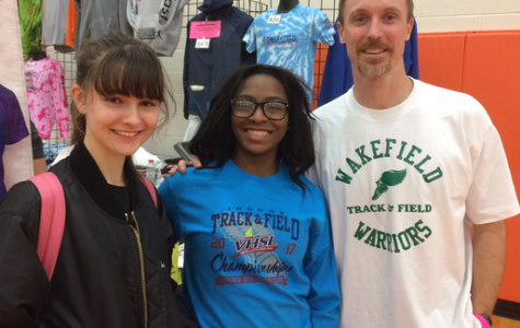 Cierra Jenkins (center) is all smiles after running the 55m dash at States on Friday.