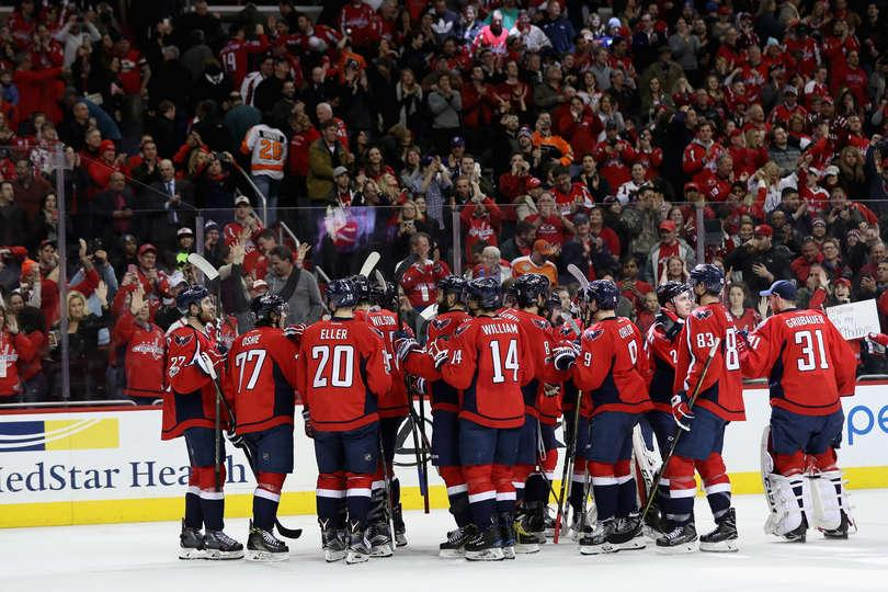 While being surrounded by thousands of fans, the Capitals take a moment to strategize.