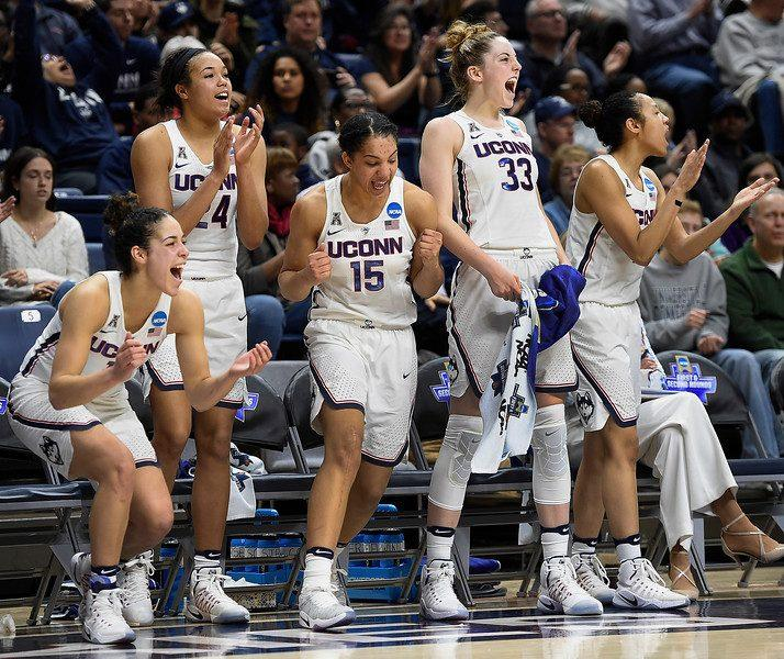 UConn, the reigning champs for four consecutive years now, celebrating one of their many victories.