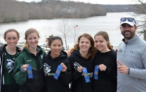 The Women's Lightweight Four posing with their first place ribbons and Coach James Augone.
