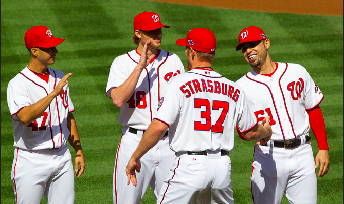 Before+the+game+starting+pitcher+Stephen+Strasburg+goes+for+a+high-five+from+his+teammates.