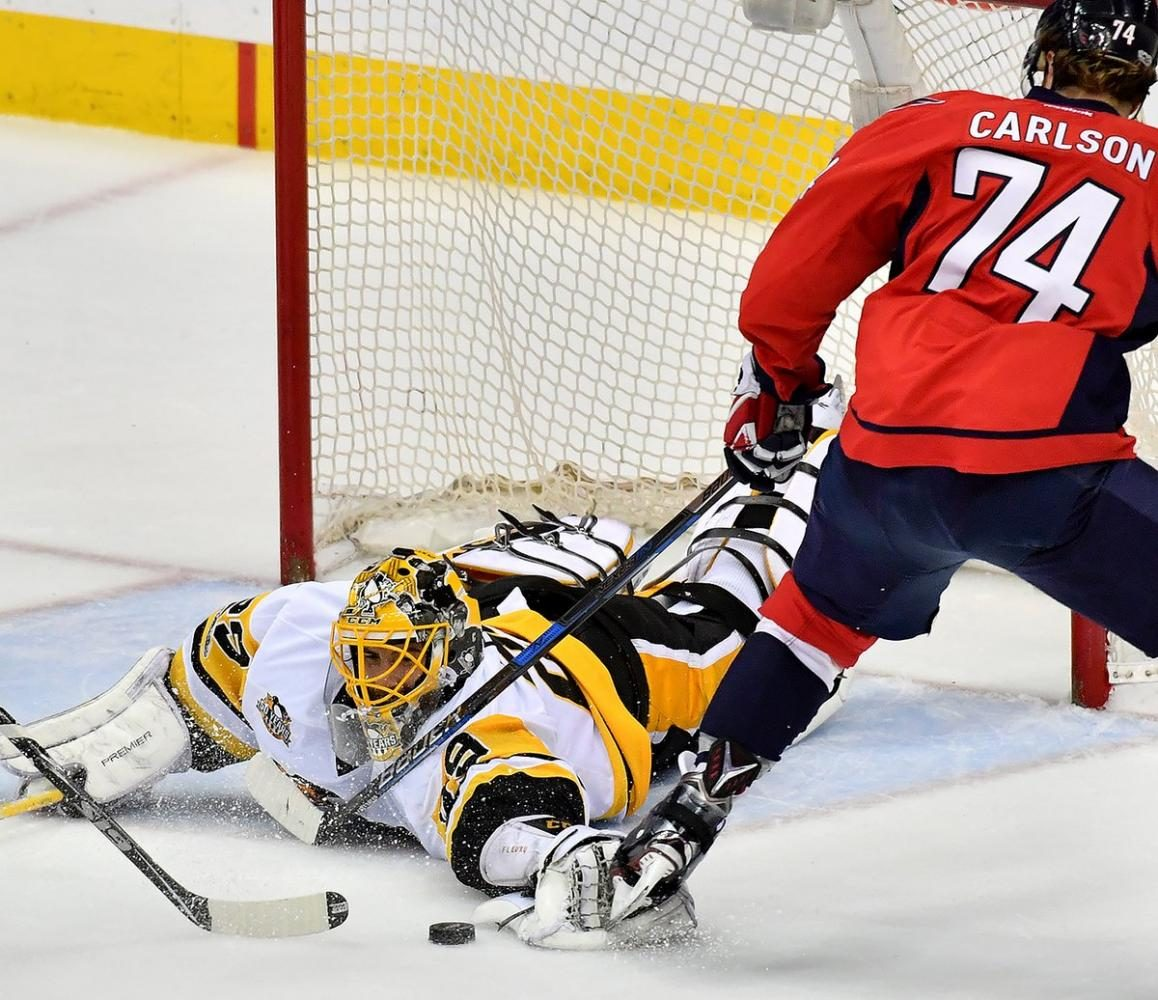 Penguins goaltender Marc-Andre Fleury makes another incredible save against the Capitals.