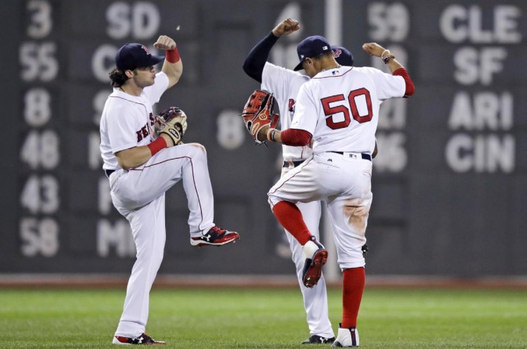 +Boston+Red+Sox+outfielders+celebrate+a+win+by+dancing%21+%0A