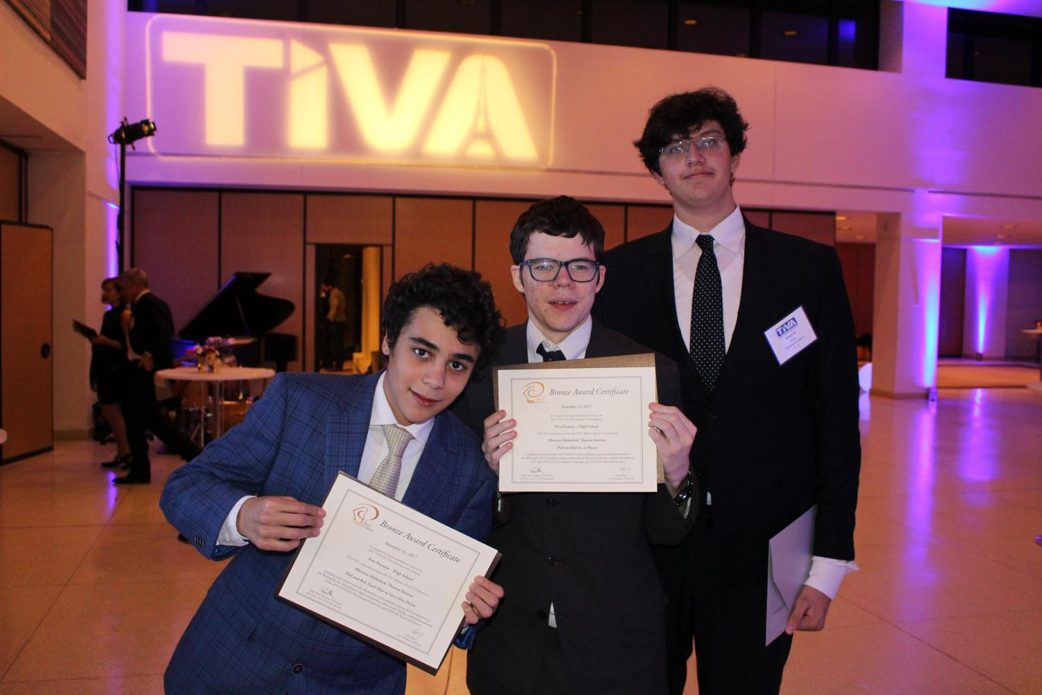 The night of the Awards Show, Marwan, Thomas, and Kalin show off their certificates.