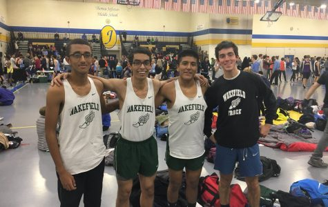 The indoor track team celebrating after a great meet. (Photo found @runwakefield)