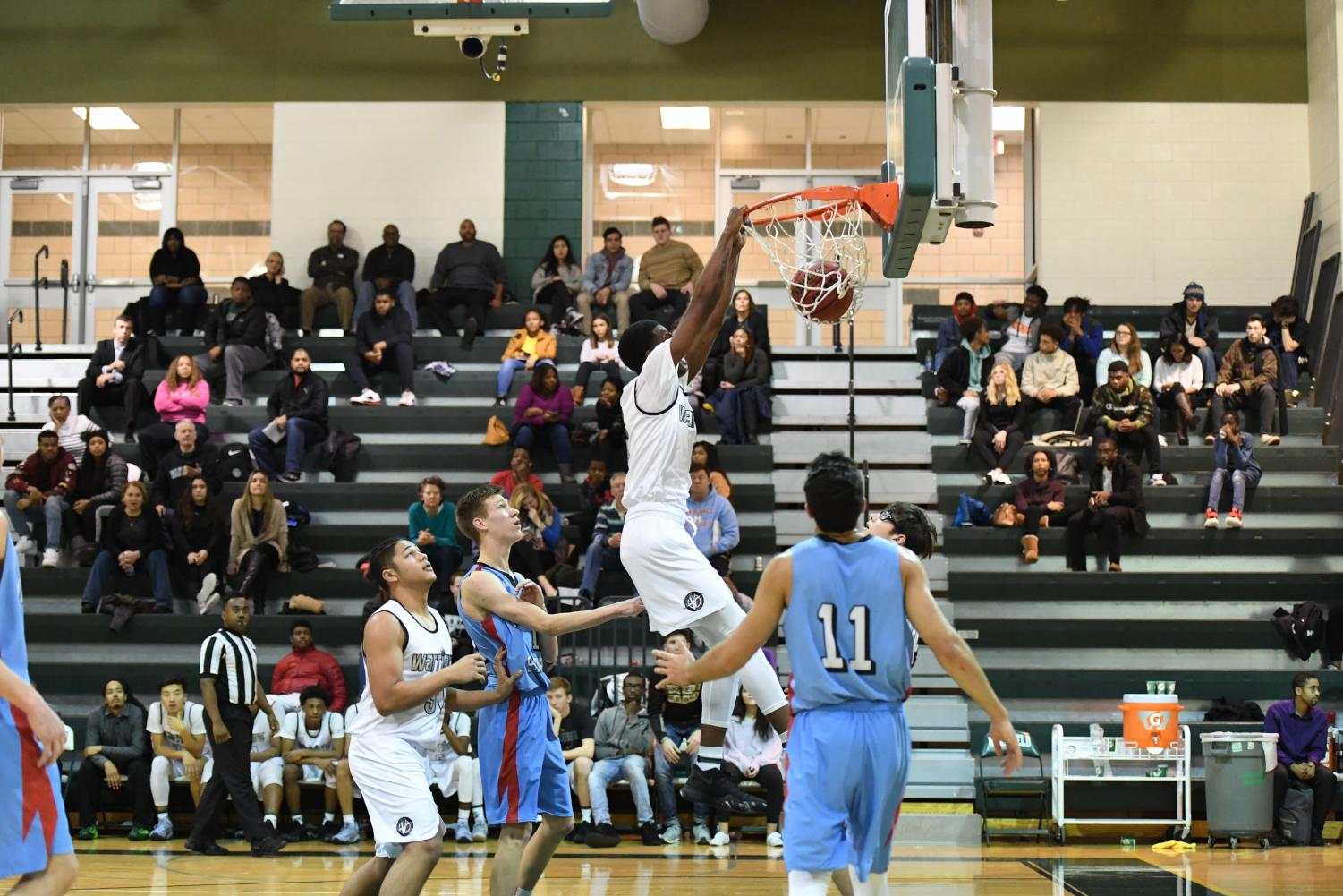 Senior A'Mari Cooper dunks over Marshall defenders.