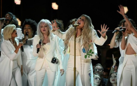Grammy Goers Use A White Rose As A Symbol of Unity
