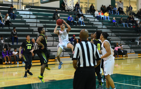 Senior Ben Horsford goes up for a contested shot against LEE High School.