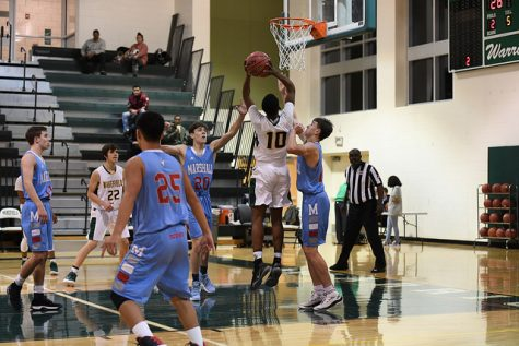 Sophomore, Zion Gladden goes up for a shot against Marshall.