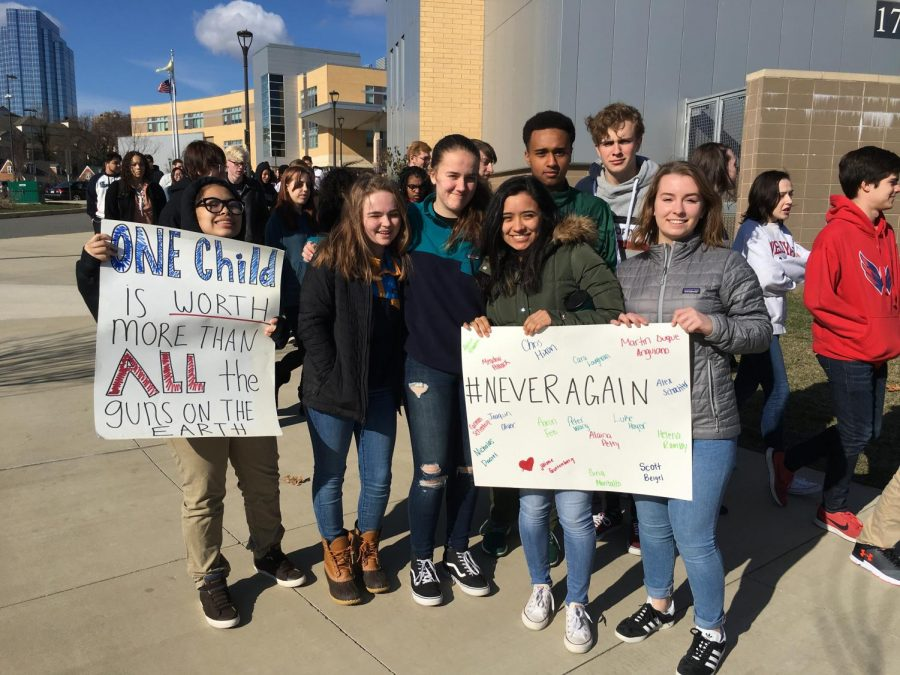 Juniors Mary-Faith Melgar, Parker Michos, Mia Larsen, Ileana Mendez, Mussé Yimer, Anton Katula and Hannah Jones stand with their signs ready for the walk out.