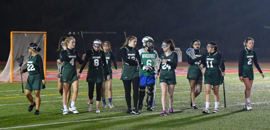The+Girls+Lacrosse+Team+walks+away+happy+after+a+victory+at+Stuart