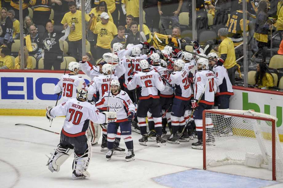 Caps celebrate big win over Penguins!  Photo found at SFGate.com