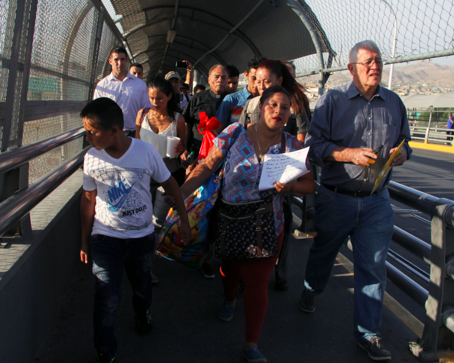 U.S. activist Ricardo Garcia (R) from Casa Asuncion shelter, accompanies six Honduran and Guatemalan migrants to ask for political asylum in the U.S. They are at the Paso del Norte International Bridge, in Ciudad Juarez Chihuahua, Mexico on the border with El Paso, Texas. This photo was taken on June 15, 2018.
