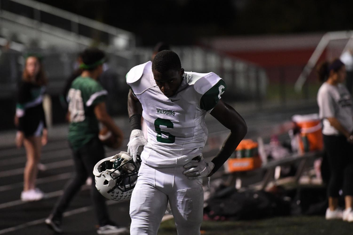 Senior Jaleel Prather steps off the field in between possessions to catch his breath.