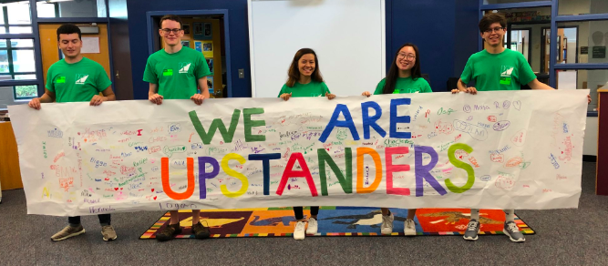 Upstanders+standing+with+the+Campbell+Elementary+banner