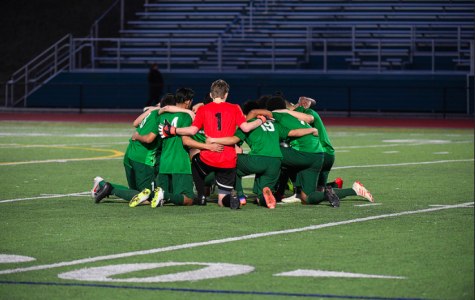 The boys in a huddle before the first game.