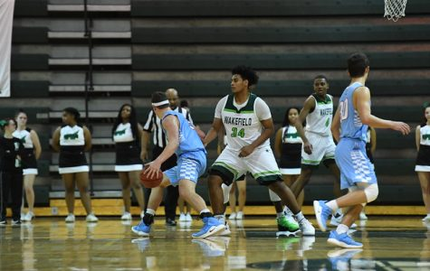 Here I am playing defense on the home court in my last regular season game.