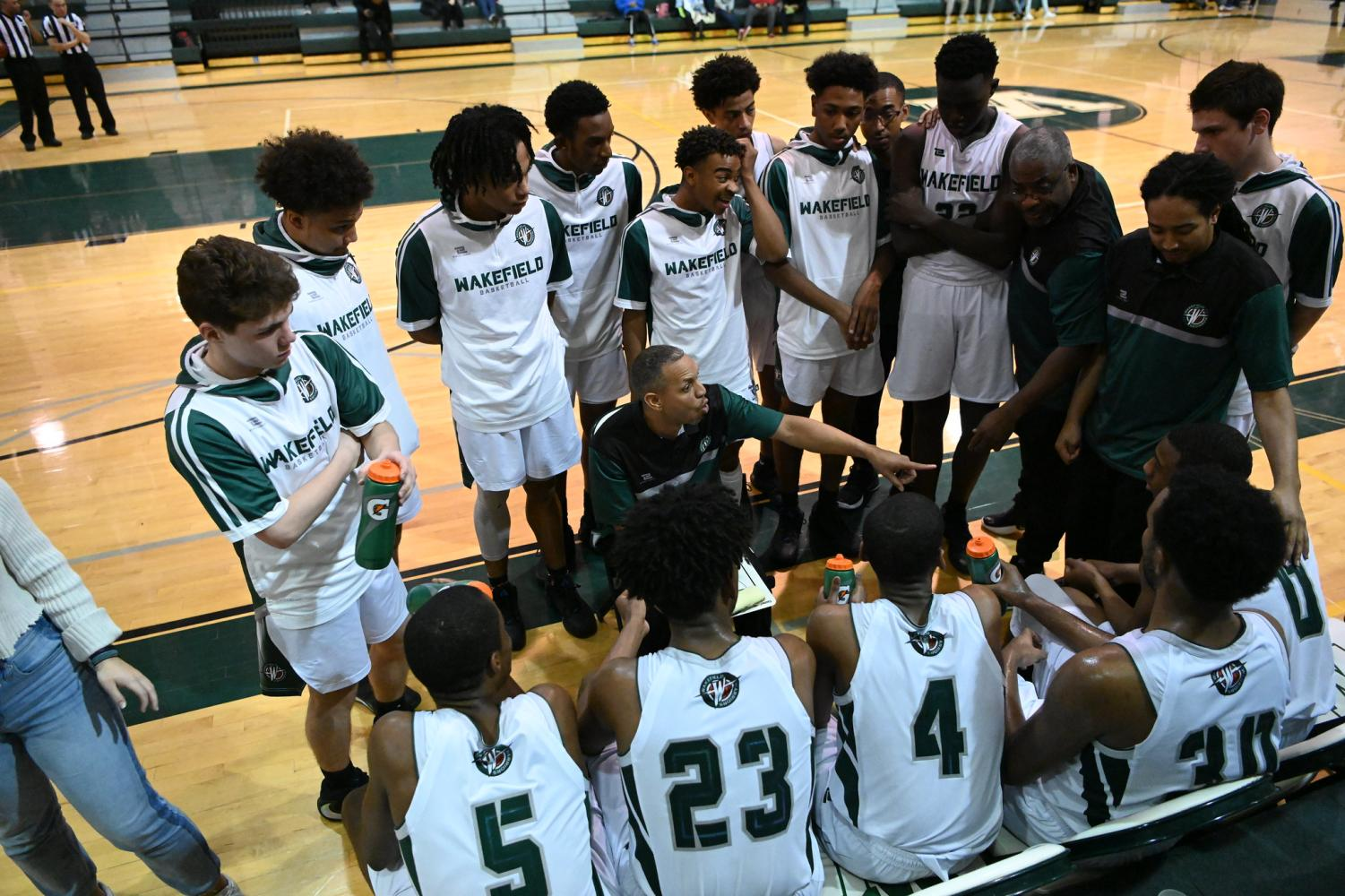 The team in a huddle at Wakefield vs. Marshall earlier this season.