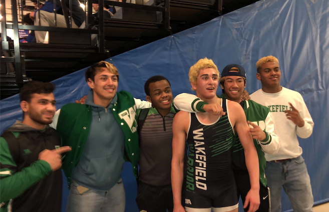 Steven, 3rd from right, moments after he was named State Champion surrounded by fellow wrestlers.