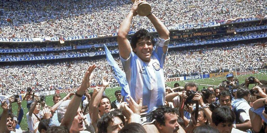 Diego Maradona holds up his teams trophy after Argentinas 3-2 victory over West Germany at the World Cup final match. (Photo | AP)