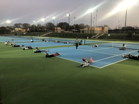 Boys Basketball conditioning on the Tennis Courts in October.